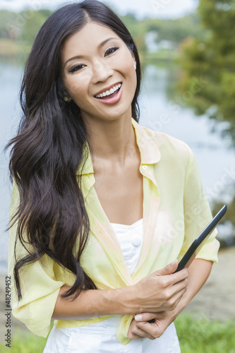 Asian Chinese Woman Student With Tablet Computer
