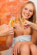 Wellness - female friends drinking champagne in spa