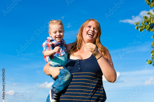 Family - mother and child playing in garden