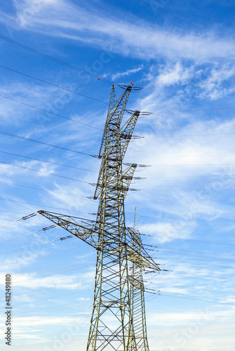 electrical tower in landscape with street