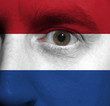 face with the Dutch flag painted on it