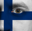 face with the Finnish flag painted on it