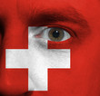 face with the Swiss flag painted on it