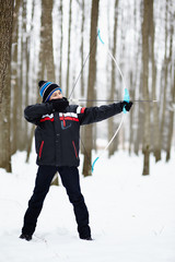 Boy shooting with the bow