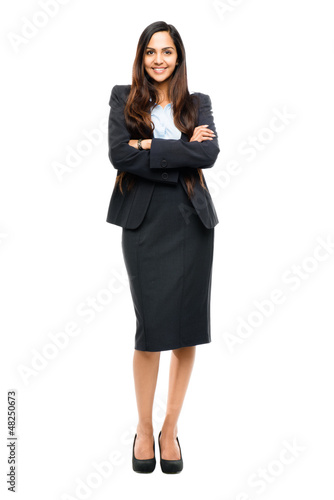 Full length portrait of attractive Indian businesswoman arms fol