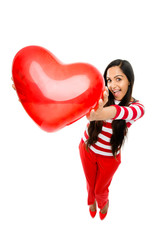 Valentines day portrait of Pretty Indian woman holding red heart