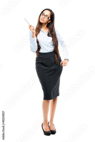 Full length portrait of attractive Indian businesswoman thinking