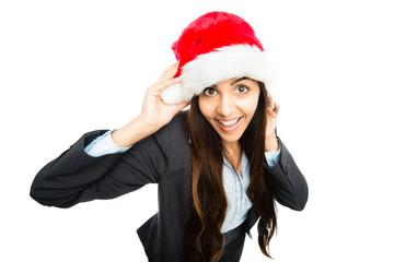 Happy businesswoman celebrating christmas wearing santa hat isoa
