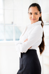 Portrait of attractive Indian businesswoman in  modern office