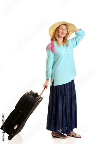 young woman traveling with luggage