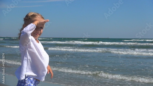 Little Girl Shading her Eyes Looking at the Sea, Child on Beach