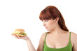 Young attractive woman eating hamburger