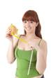 Young attractive woman eating hamburger