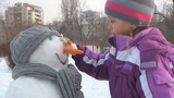 Child Finishing a Snowman, Winter Games