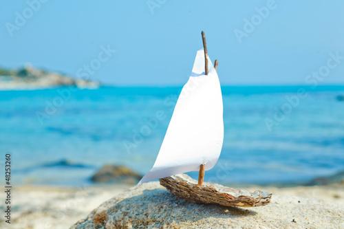 Leinwandbild Motiv Ship toy model on the beach