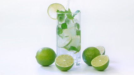 Mojito cocktail with halves of limes