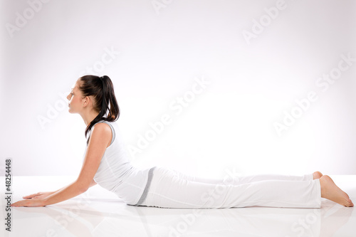Young Caucasian woman lying in yoga position