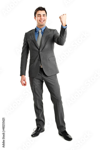 Businessman raising arms in sign of victory.