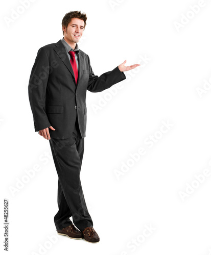 Full length businessman showing something