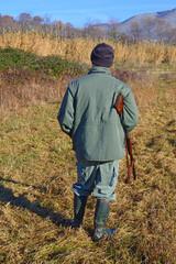 Cacciatore in riserva di caccia