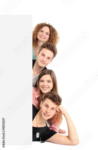 Happy group of people with a banner - isolated over a white