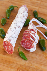 Meat fuet sausages with green peppers