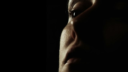 Slow motion of a girls face in the dark