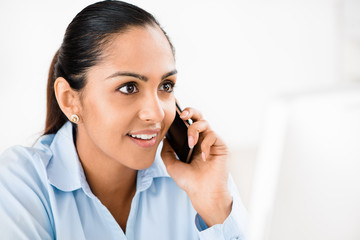 Indian business woman mobile phone excited