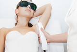 Young woman receiving epilation laser treatment