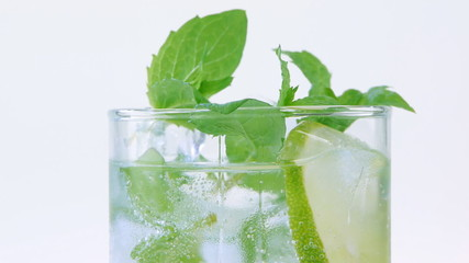 Mojito cocktail closeup on white background
