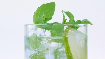 Mojito cocktail closeup on white background