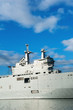 Military ship detail over blue sky.