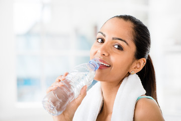Beautiful Indian woman drinking water  fitness healthy happy