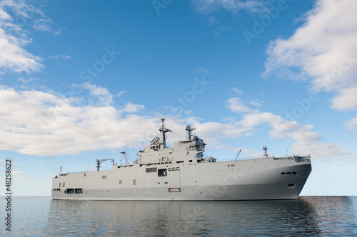 Military ship and blue sky.