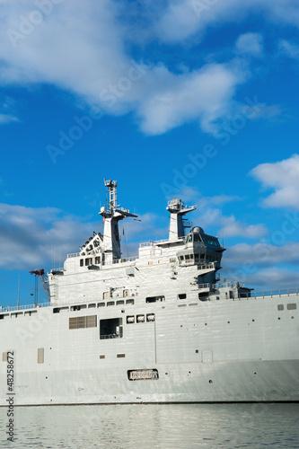 Military ship detail over blue sky.