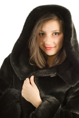 Young girl in a natural fur coat.