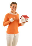 Real estate broker holding small house isolated on white poster