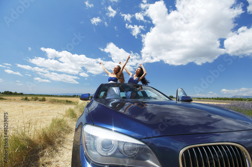 women dance in car