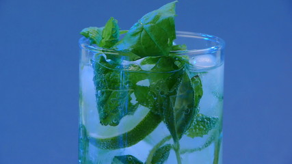 Mojito cocktail closeup on blue background