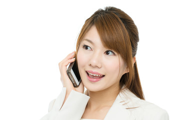 Beautiful asian businesswoman using a cellular