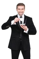 Stylish man holding a coffee cup.