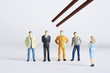 Figurines with different professions standing in a row