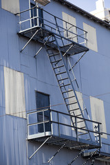 White Metal and Blue Metal Building with Fire Escape