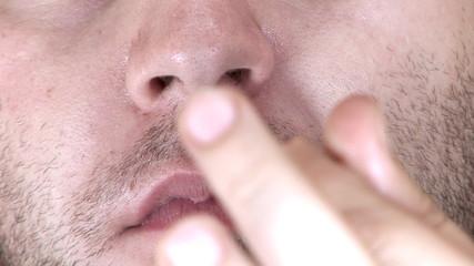 Man picking his nose