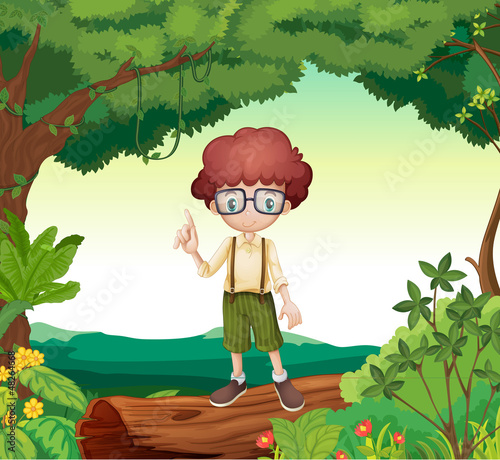 A boy standing on dry wood