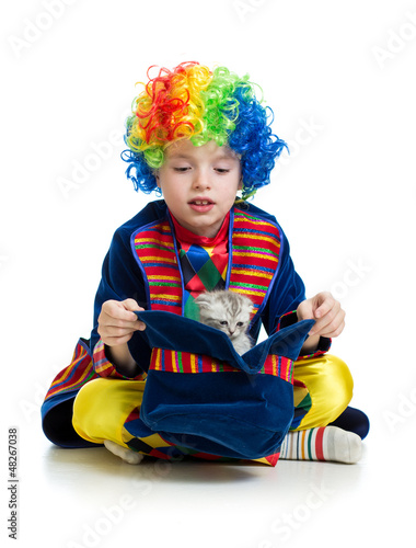 Boy clown with kitten inside hat over the white background