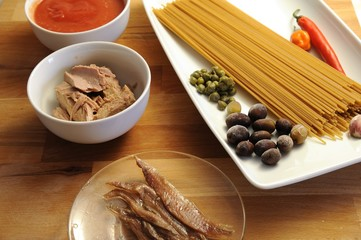 Ingredients for spaghetti with puttanesca sauce