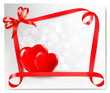 Valentine background with two red hearts and gift bow and ribbon