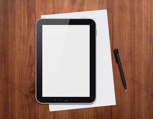 Digital tablet with pen on a desk