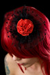 Red haired gothic girl with black hair fascinator
